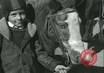 Image of Young children riding horses Kansas City Missouri USA, 1934, second 48 stock footage video 65675022443