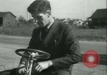 Image of motor scooter United States USA, 1933, second 13 stock footage video 65675022493