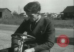 Image of motor scooter United States USA, 1933, second 14 stock footage video 65675022493