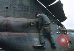 Image of United States Marines salvage parts from a helicopter Vietnam, 1968, second 11 stock footage video 65675022557