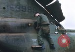 Image of United States Marines salvage parts from a helicopter Vietnam, 1968, second 15 stock footage video 65675022557