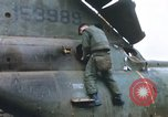 Image of United States Marines salvage parts from a helicopter Vietnam, 1968, second 19 stock footage video 65675022557