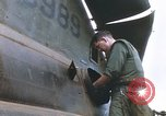 Image of United States Marines salvage parts from a helicopter Vietnam, 1968, second 27 stock footage video 65675022557