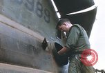 Image of United States Marines salvage parts from a helicopter Vietnam, 1968, second 28 stock footage video 65675022557