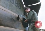 Image of United States Marines salvage parts from a helicopter Vietnam, 1968, second 30 stock footage video 65675022557
