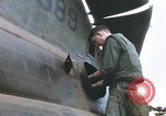 Image of United States Marines salvage parts from a helicopter Vietnam, 1968, second 31 stock footage video 65675022557