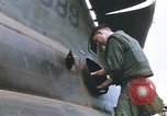 Image of United States Marines salvage parts from a helicopter Vietnam, 1968, second 32 stock footage video 65675022557