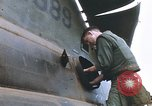 Image of United States Marines salvage parts from a helicopter Vietnam, 1968, second 33 stock footage video 65675022557