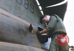 Image of United States Marines salvage parts from a helicopter Vietnam, 1968, second 36 stock footage video 65675022557