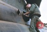 Image of United States Marines salvage parts from a helicopter Vietnam, 1968, second 37 stock footage video 65675022557