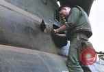Image of United States Marines salvage parts from a helicopter Vietnam, 1968, second 38 stock footage video 65675022557