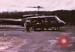 Image of operation on wounded soldier Vietnam, 1969, second 2 stock footage video 65675022610