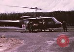 Image of operation on wounded soldier Vietnam, 1969, second 3 stock footage video 65675022610