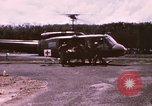 Image of operation on wounded soldier Vietnam, 1969, second 5 stock footage video 65675022610