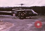 Image of operation on wounded soldier Vietnam, 1969, second 6 stock footage video 65675022610