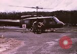 Image of operation on wounded soldier Vietnam, 1969, second 7 stock footage video 65675022610