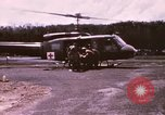 Image of operation on wounded soldier Vietnam, 1969, second 8 stock footage video 65675022610