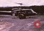 Image of operation on wounded soldier Vietnam, 1969, second 9 stock footage video 65675022610