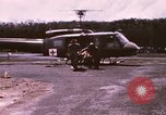 Image of operation on wounded soldier Vietnam, 1969, second 10 stock footage video 65675022610