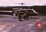 Image of operation on wounded soldier Vietnam, 1969, second 11 stock footage video 65675022610