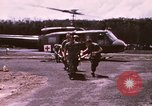 Image of operation on wounded soldier Vietnam, 1969, second 13 stock footage video 65675022610