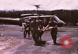 Image of operation on wounded soldier Vietnam, 1969, second 14 stock footage video 65675022610