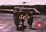 Image of operation on wounded soldier Vietnam, 1969, second 15 stock footage video 65675022610