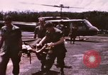 Image of operation on wounded soldier Vietnam, 1969, second 16 stock footage video 65675022610
