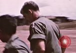 Image of operation on wounded soldier Vietnam, 1969, second 20 stock footage video 65675022610