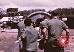Image of operation on wounded soldier Vietnam, 1969, second 23 stock footage video 65675022610