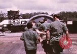 Image of operation on wounded soldier Vietnam, 1969, second 24 stock footage video 65675022610