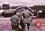 Image of operation on wounded soldier Vietnam, 1969, second 25 stock footage video 65675022610