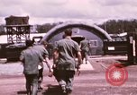 Image of operation on wounded soldier Vietnam, 1969, second 28 stock footage video 65675022610