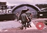 Image of operation on wounded soldier Vietnam, 1969, second 32 stock footage video 65675022610