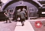 Image of operation on wounded soldier Vietnam, 1969, second 36 stock footage video 65675022610