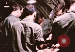 Image of operation on wounded soldier Vietnam, 1969, second 44 stock footage video 65675022610