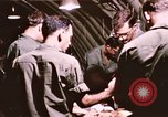 Image of operation on wounded soldier Vietnam, 1969, second 45 stock footage video 65675022610