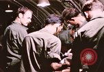 Image of operation on wounded soldier Vietnam, 1969, second 46 stock footage video 65675022610