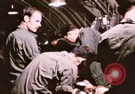 Image of operation on wounded soldier Vietnam, 1969, second 49 stock footage video 65675022610