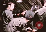Image of operation on wounded soldier Vietnam, 1969, second 50 stock footage video 65675022610
