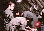Image of operation on wounded soldier Vietnam, 1969, second 51 stock footage video 65675022610
