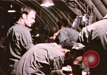 Image of operation on wounded soldier Vietnam, 1969, second 52 stock footage video 65675022610