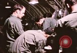 Image of operation on wounded soldier Vietnam, 1969, second 53 stock footage video 65675022610