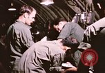 Image of operation on wounded soldier Vietnam, 1969, second 54 stock footage video 65675022610