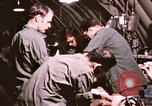 Image of operation on wounded soldier Vietnam, 1969, second 55 stock footage video 65675022610