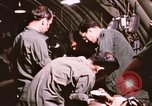 Image of operation on wounded soldier Vietnam, 1969, second 56 stock footage video 65675022610