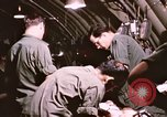 Image of operation on wounded soldier Vietnam, 1969, second 57 stock footage video 65675022610