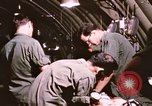 Image of operation on wounded soldier Vietnam, 1969, second 58 stock footage video 65675022610