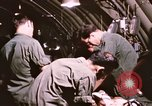 Image of operation on wounded soldier Vietnam, 1969, second 59 stock footage video 65675022610