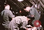 Image of operation on wounded soldier Vietnam, 1969, second 61 stock footage video 65675022610